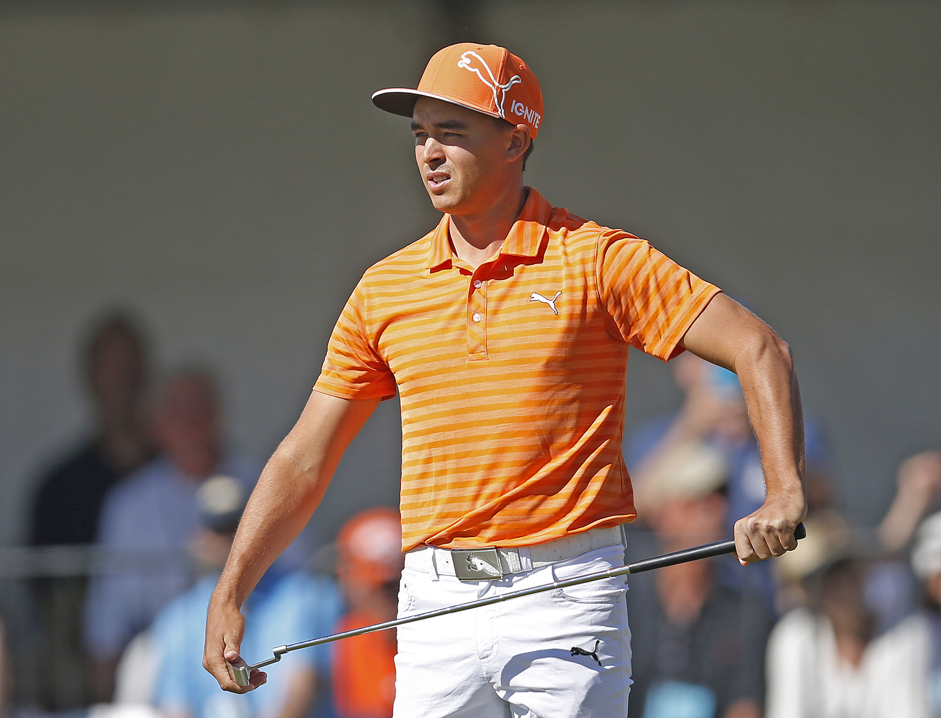 Rickie Fowler reacts after missing a birdie putt on the fourth hole during the final round of the Phoenix Open golf tournament, Sunday, Feb. 7, 2016, in Scottsdale, Ariz.