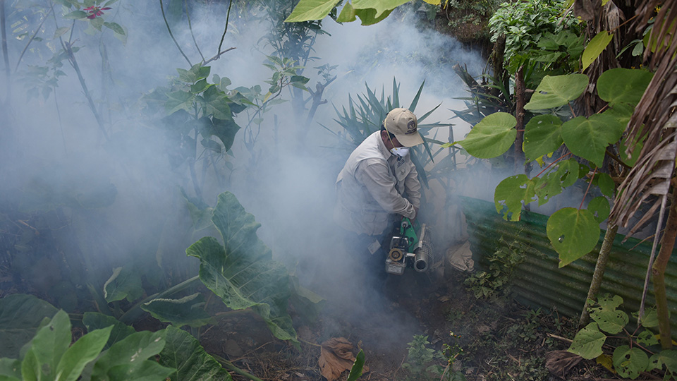 Health Ministry employees fumigate against the Aedes aegypti mosquito, vector of the dengue, Zika and Chikungunya viruses at La Comuna II neighborhood in Guatemala City on February 5, 2016.