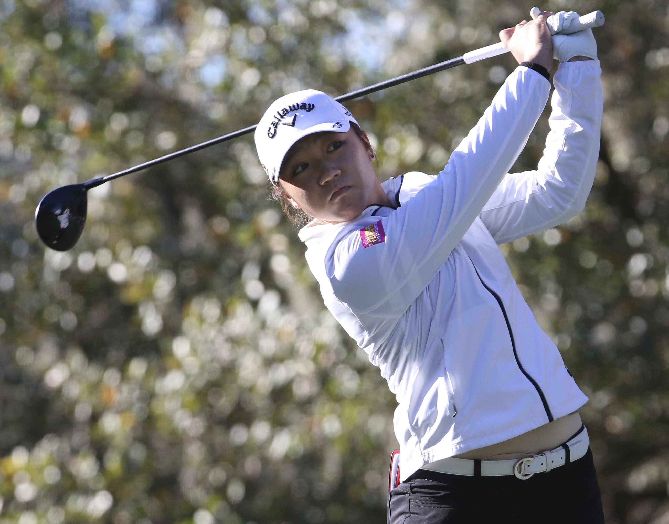 Lydia Ko watches the flight of her ball from the first tee during the third round of the LPGA Coates Golf Championship at the Golden Ocala Golf and Equestrian Club in Ocala, Fla. on Friday, Feb. 5, 2016. (Bruce Ackerman/Star-Banner via AP) MAGS OUT;