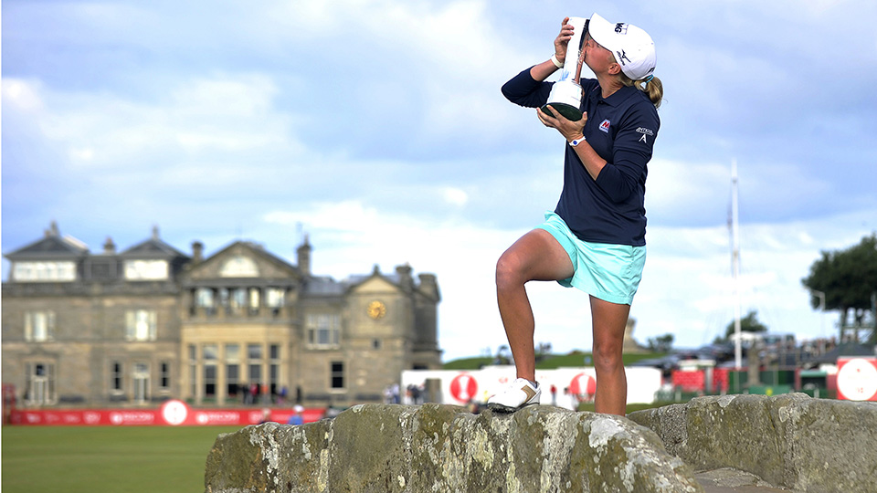 Stacy Lewis kisses the trophy on the Swilcan Bridge after winning the 2013 Women's British Open Golf Championship at the Old Course in St Andrews, Scotland.