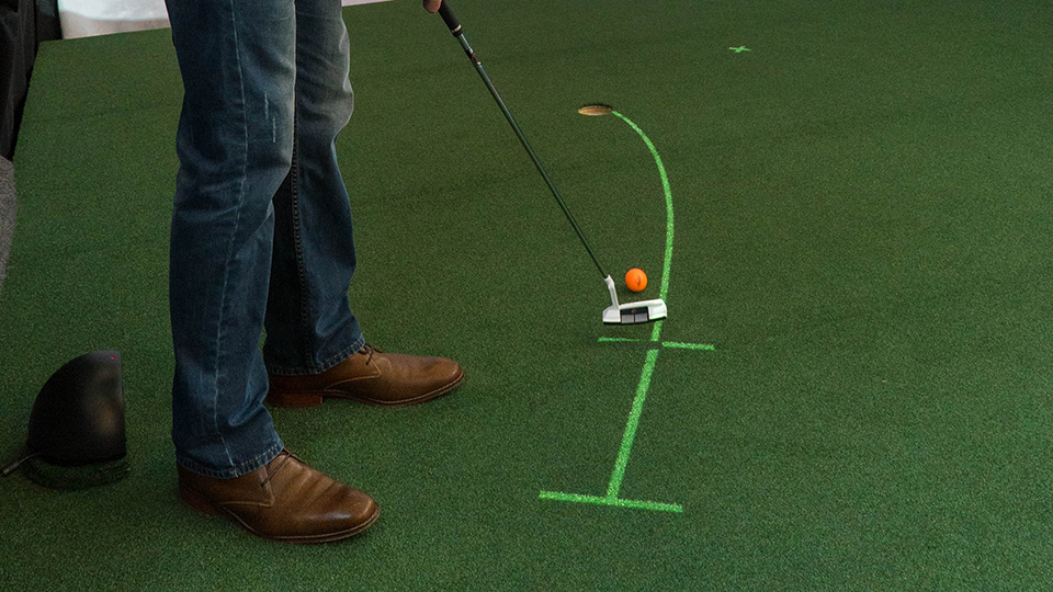 One of Golfstream's mini-games includes laser projections to help the player's putting.