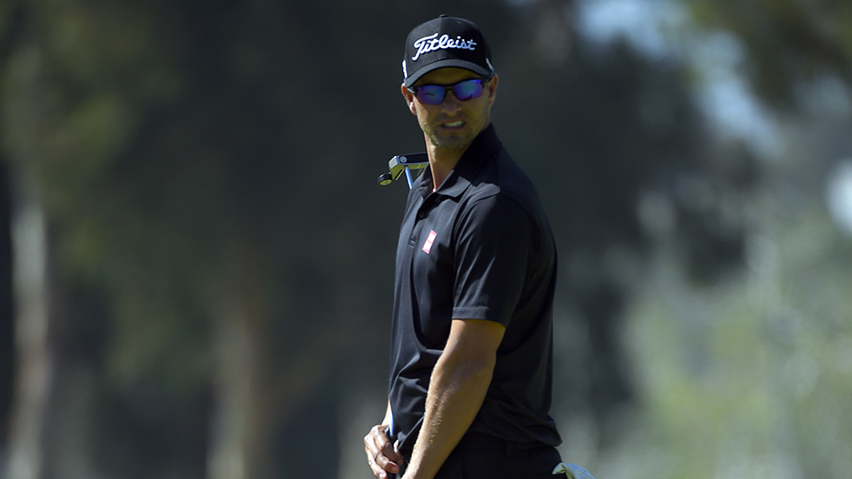 Adam Scott misses a putt on the eighth green in the third round of the Northern Trust Open golf tournament Saturday, Feb. 20, 2016, in the Pacific Palisades area of Los Angeles.
