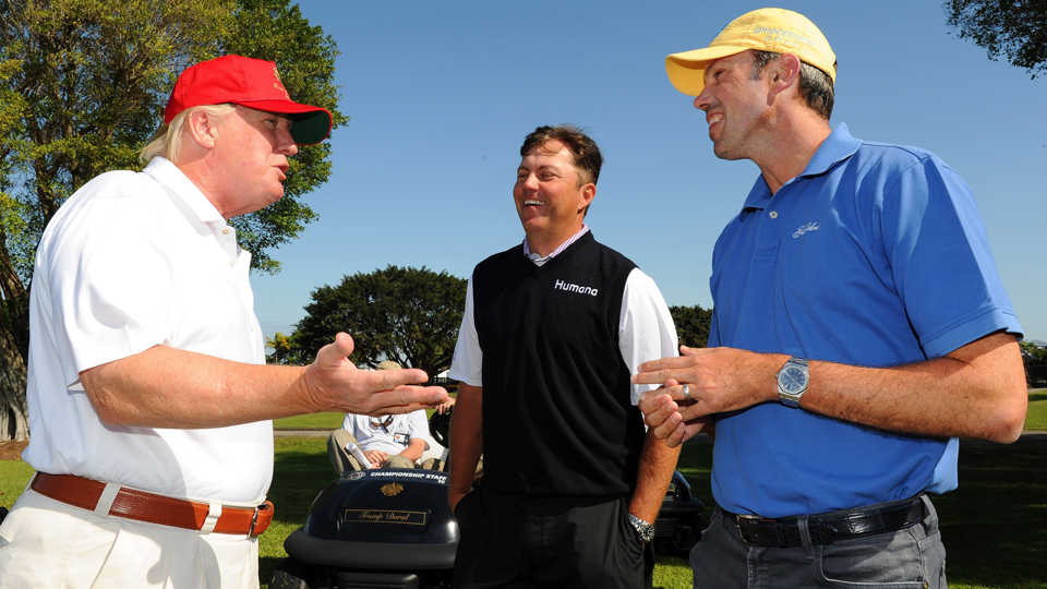 Donald Trump greets Bo Van Pelt and Matt Kuchar during the WGC-Cadillac Championship at Doral in 2013.