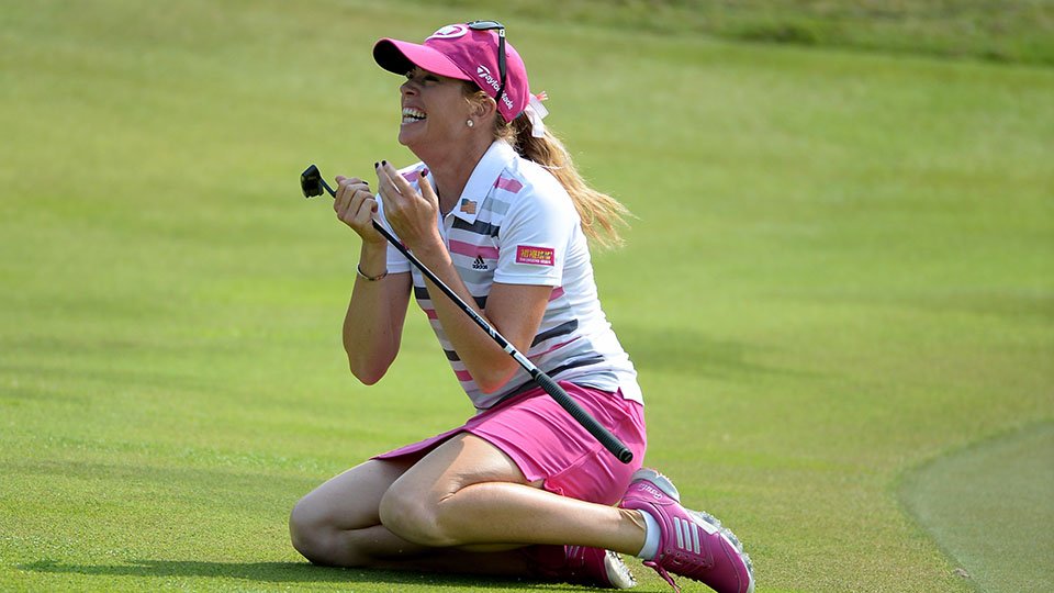 Paula Creamer celebrates after holing an eagle putt to seal victory in a play-off against Azahara Munoz during the final round of the 2014 HSBC Women's Champions in Singapore.