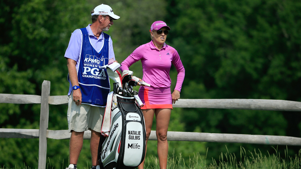 Natalie Gulbis stands with her caddie Greg Sheridan on the sixth tee box during the second round of the KPMG Women's PGA Championship held at Westchester Country Club on June 12, 2015, in Harrison, New York.
