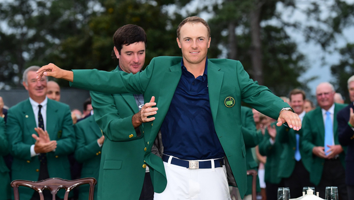 Jordan Spieth finally tastes redemption from the 2014 event, setting a major low-scoring record to win the 2015 Masters at 18 under par.