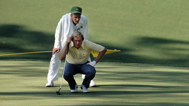 Jack NIcklaus and caddy, son, Jackie Nicklaus, line up a putt during the 1986 Masters Tournament