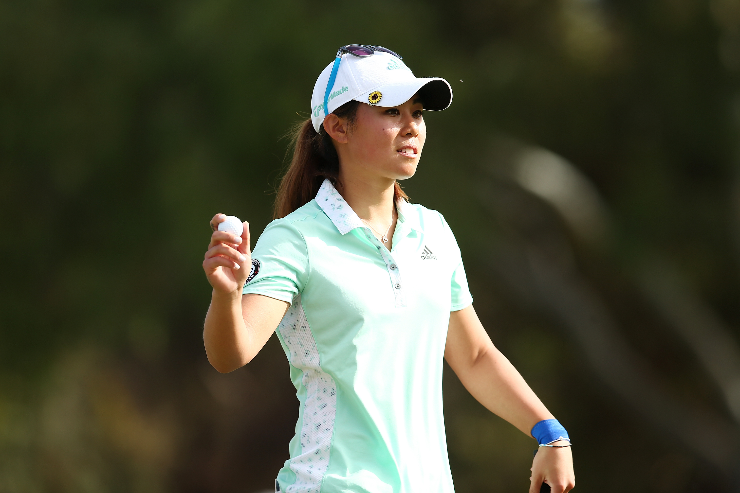 Danielle Kang waves to fans during day four of the ISPS Handa Women's Australian Open at The Grange GC on February 21, 2016 in Adelaide, Australia.