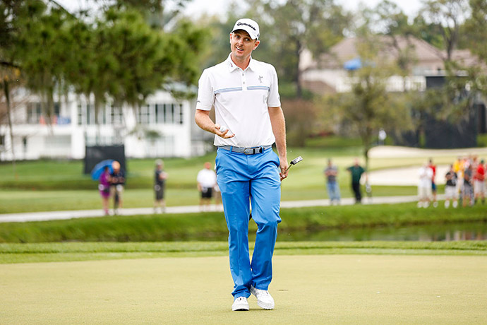 Justin Rose of England smiles after making a birdie putt on the 17th hole green during the third round of the Arnold Palmer Invitational presented by MasterCard at Bay Hill Club and Lodge