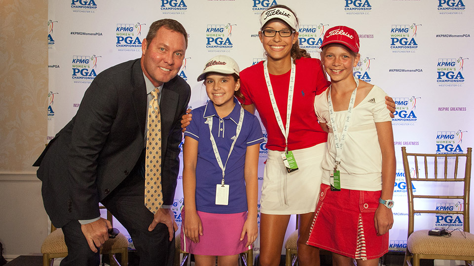 Mike Whan and 2015 Drive, Chip & Putt winners pose for a photo during the Inspire Greatness Press Conference.