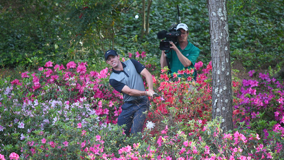 Rory McIlroy pitches out of trouble on the 13th hole during the 2014 Masters.