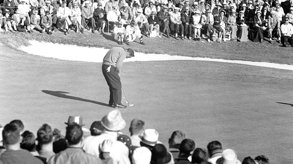 Arnold Palmer lines up his putt on 18 during the final round of his 1960 Masters victory.