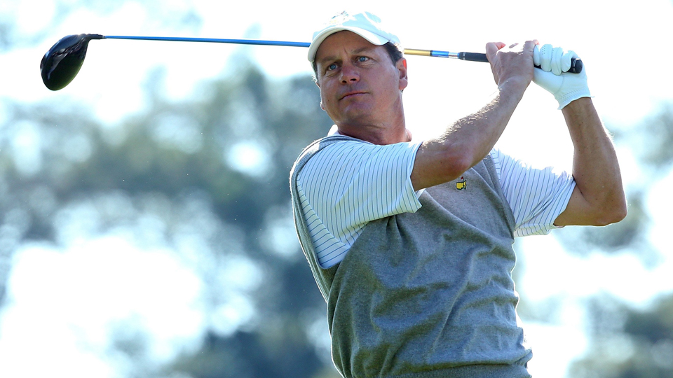 Marker Jeff Knox watches his tee shot on the first hole during the third round of the 2014 Masters. He holds the course record from the member tees, a 61.