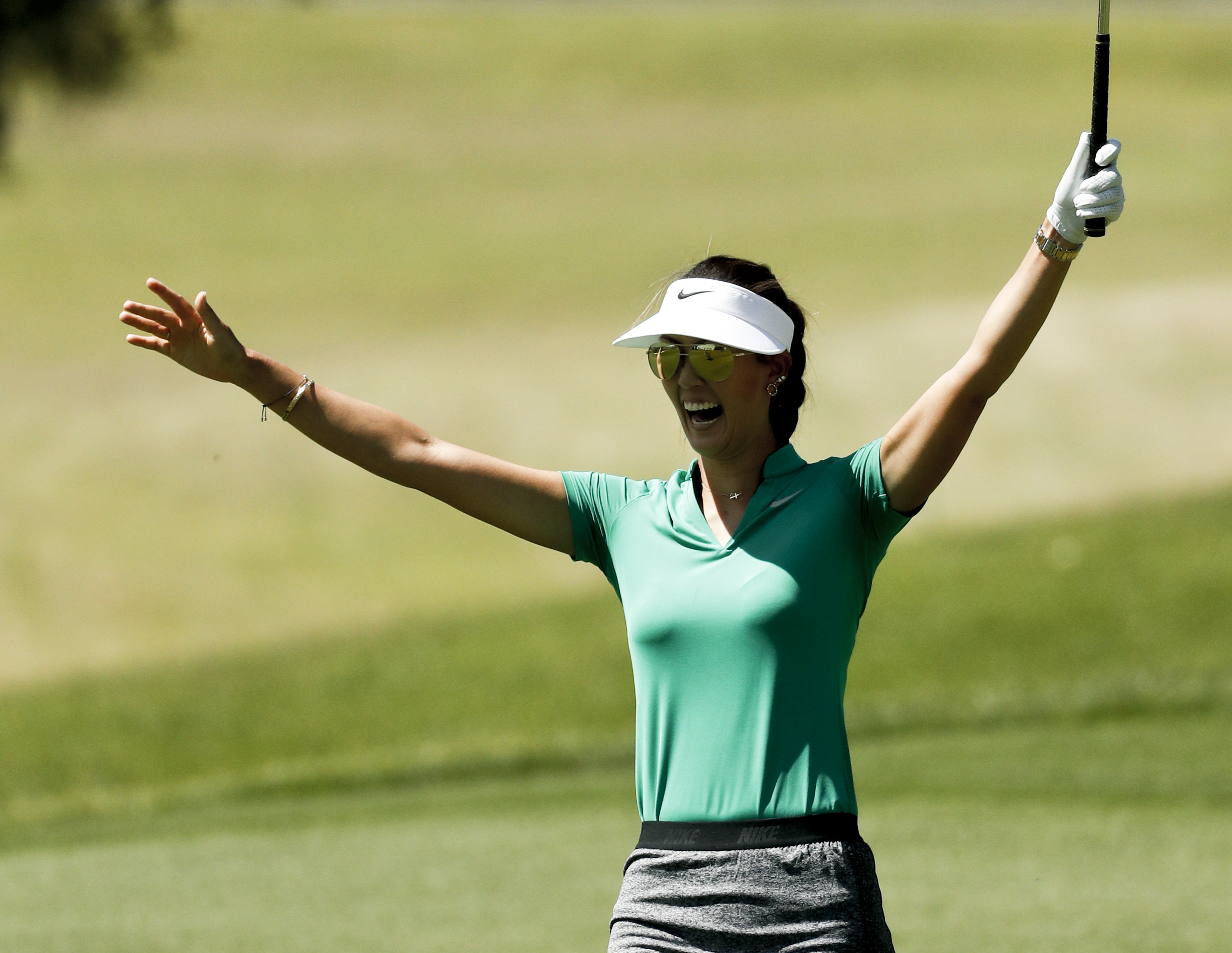 Michelle Wie celebrates after making an eagle from the fairway on the 12th hole during the second round of the LPGA Tour ANA Inspiration golf tournament at Mission Hills Country Club, Friday, April 1, 2016, in Rancho Mirage, Calif. (AP Photo/Chris