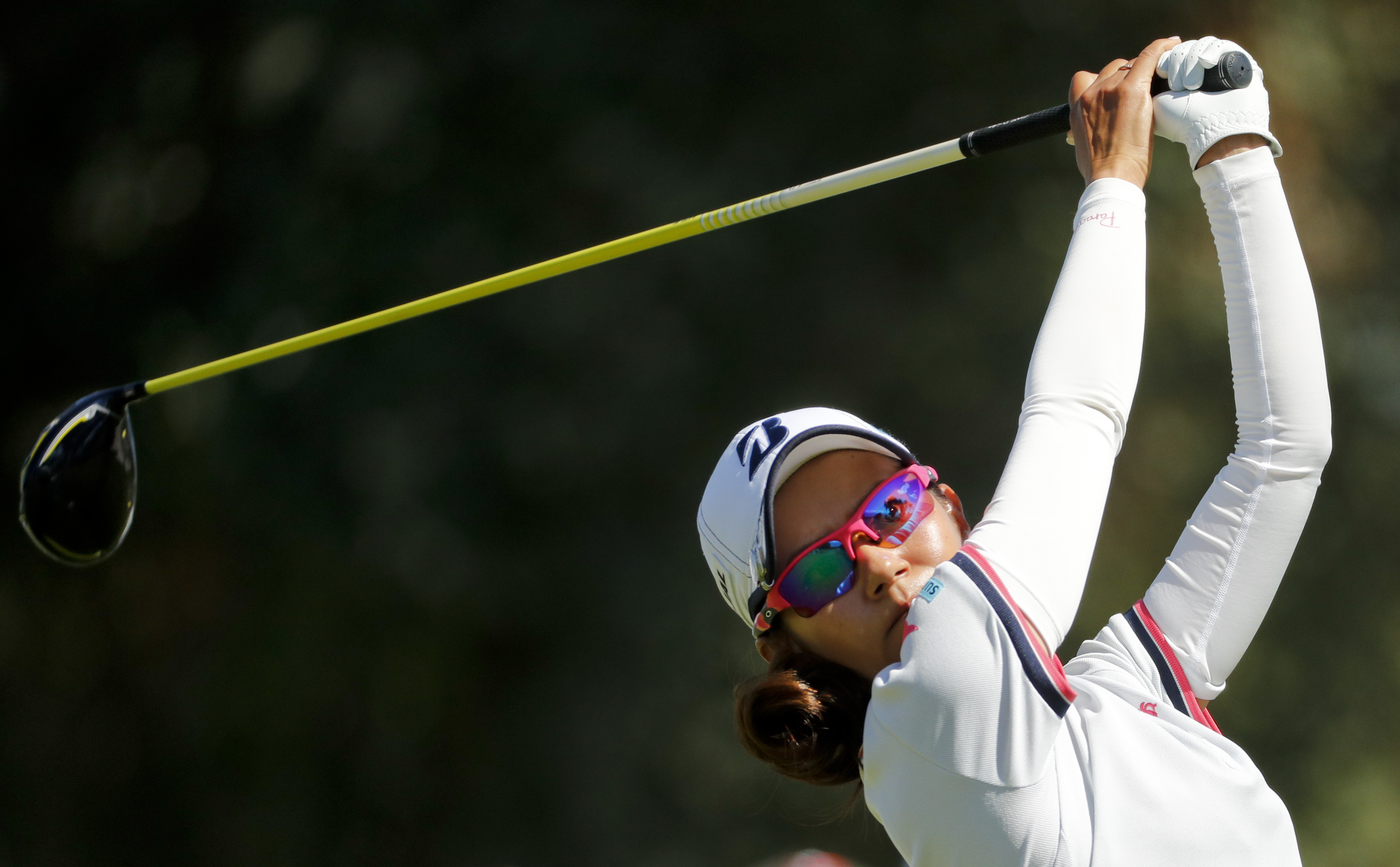 Ai Miyazato, of Japan, watches her hit shot on the 16th hole during the second round of the LPGA Tour ANA Inspiration golf tournament at Mission Hills Country Club, Friday, April 1, 2016, in Rancho Mirage, Calif. (AP Photo/Chris