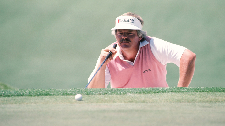 Roger Maltbie lines up a putt during the 1987 Masters.