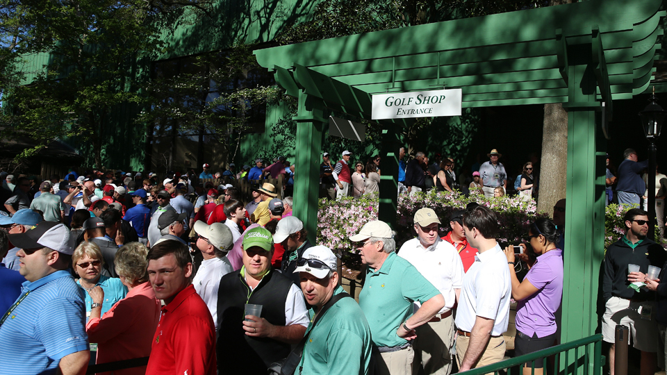 Patrons crowd the entrance to the golf shop during a practice round prior to the start of the 2015 Masters at Augusta National Golf Club on April 4, 2016, in Augusta, Georgia.