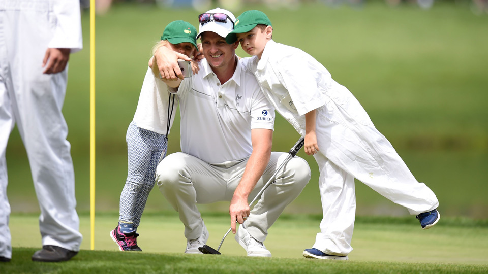 Justin Rose poses with his kids during the Masters Par 3 Contest.