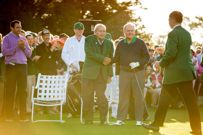 Augusta National Golf Club Chairman Billy Payne greets four-time Masters champion Arnold Palmer and six-time Masters champion Jack Nicklaus prior to the ceremonial first tee shots before the start of the 2016 Masters.