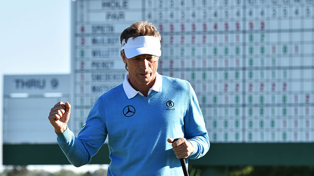 Bernhard Langer reacts after putting on the 18th green during Round 3 of the 80th Masters Golf Tournament at the Augusta National Golf Club on April 9, 2016.