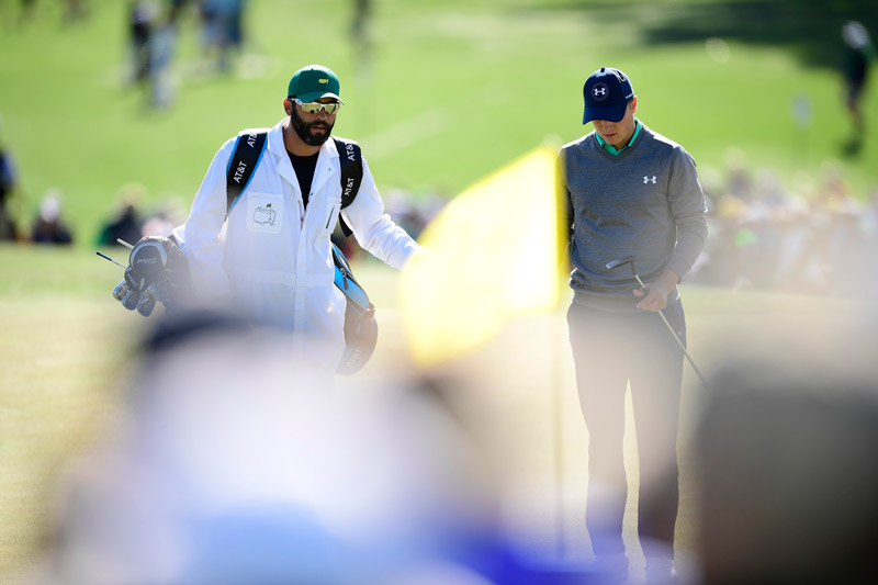 Jordan Spieth with his caddie Michael Greller.