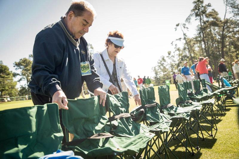 Tom and Sherry Toggweiler of Detroit place chairs near the 13th fairway prior to the second round of the 2016 Masters