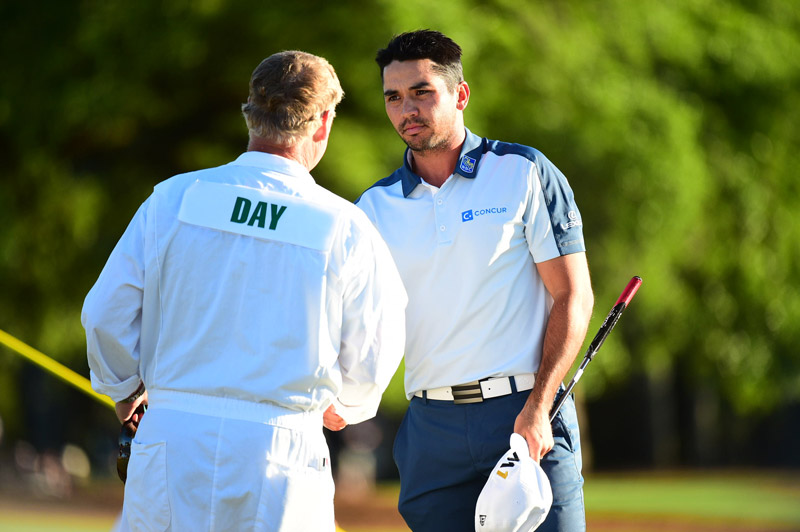 Day shakes hands with his caddie on the 18th green Sunday after a disappointing finish.