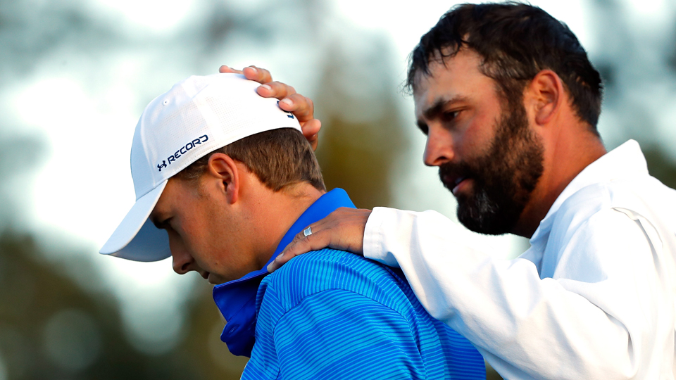 Jordan Spieth and caddie Michael Greller walk off the 18th after the final round of the Masters on Sunday.
