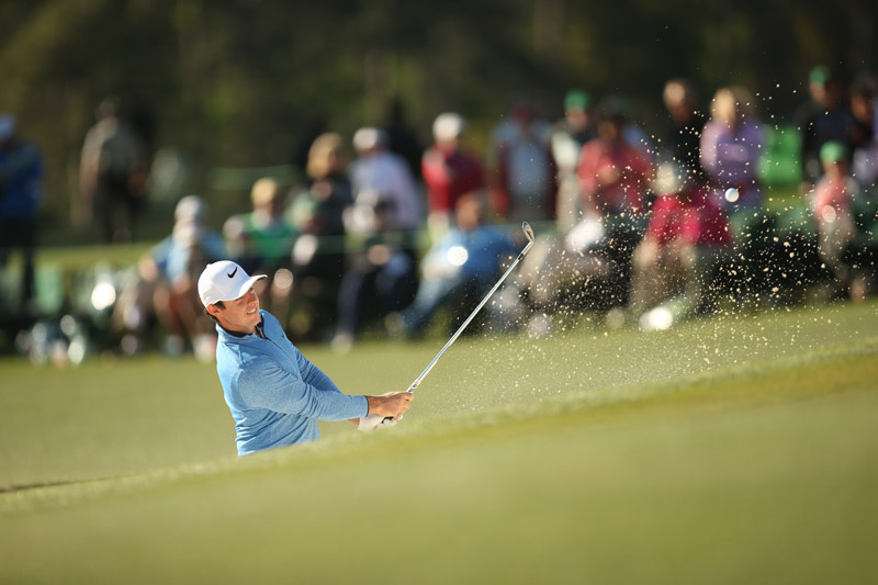 Rory McIlroy hits out of a greenside bunker on Sunday at Augusta.