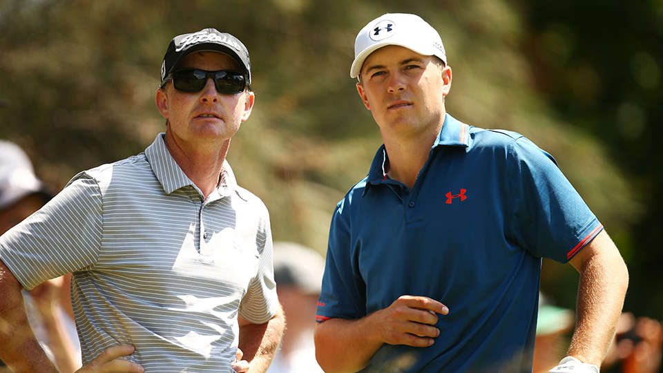 Jordan Spieth speaks to his coach Cameron McCormick during a practice round ahead of the 2015 Australian Open.