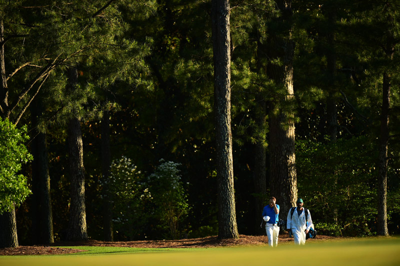 The dejected duo of Spieth and Greller walk up the 18th fairway on Sunday.
