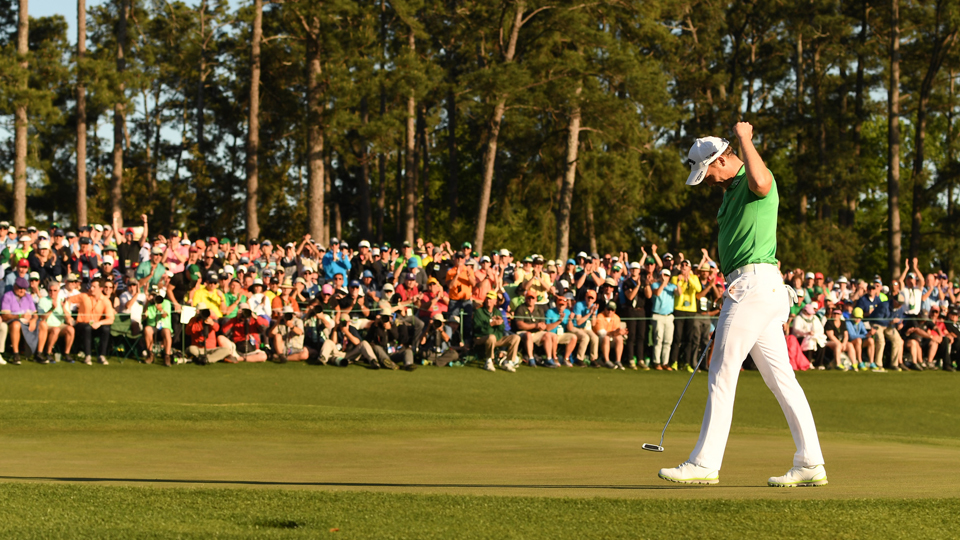 Danny Willet raises his arm after making a putt on the 18th green on Sunday. Willett won the Masters by three shots.