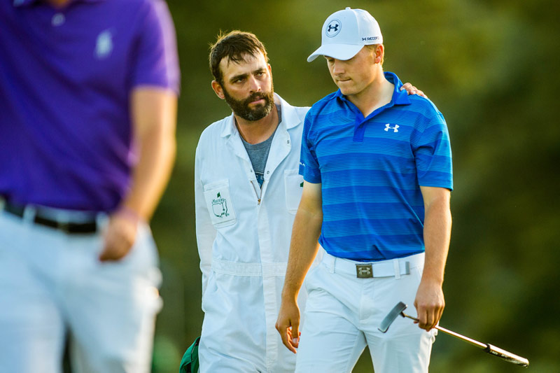 Caddie Michael Greller leaves the 18th green with Jordan Spieth at the end of the final round.