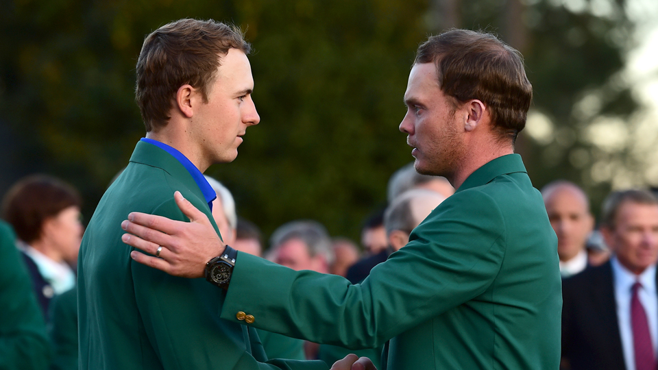After Spieth's collapse, Danny Willett (right), who turned in a flawless final round, put on the green jacket.