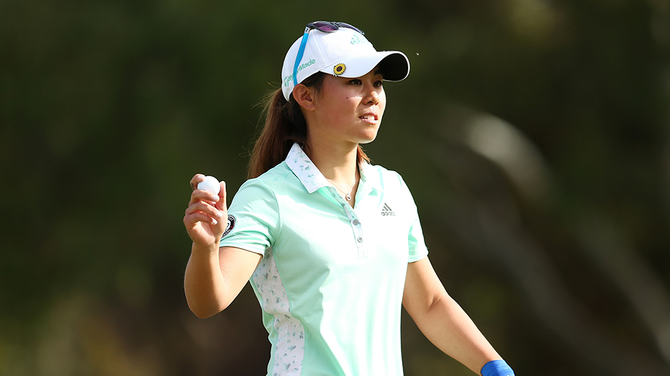 Danielle Kang of the USA waves at the crowd after completing day four of the 2016 ISPS Handa Women's Australian Open.