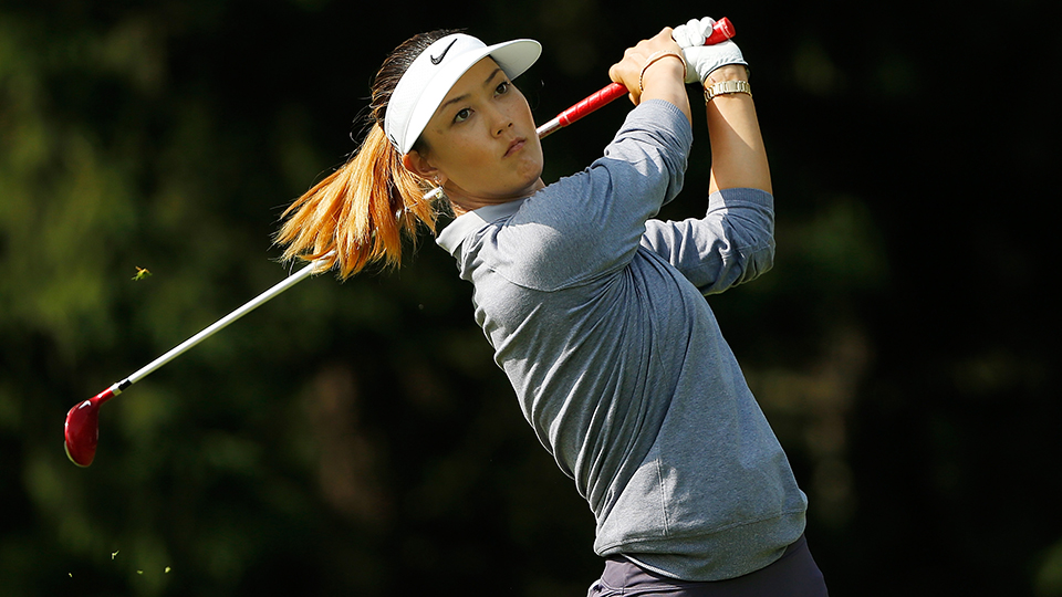 Michelle Wie watches her tee shot on the 18th hole during the second round of the 2014 Marathon Classic.