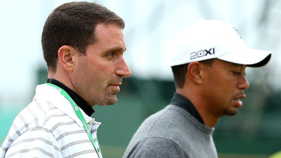 Tiger Woods walks with manager Mark Steinberg during a practice round prior to the start of the 141st Open Championship in 2012.