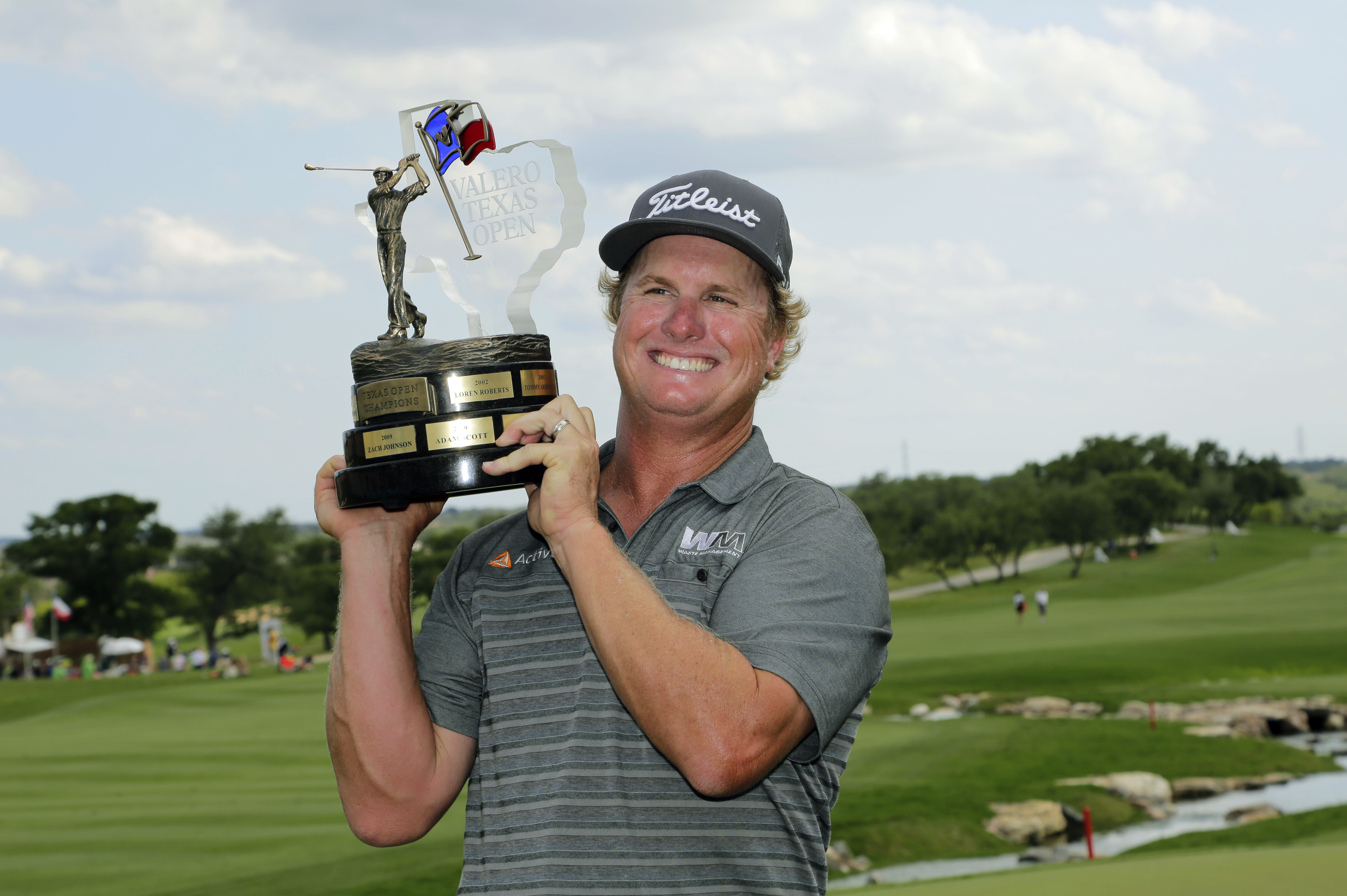 Charley Hoffman poses with his trophy after winning the Texas Open golf tournament.