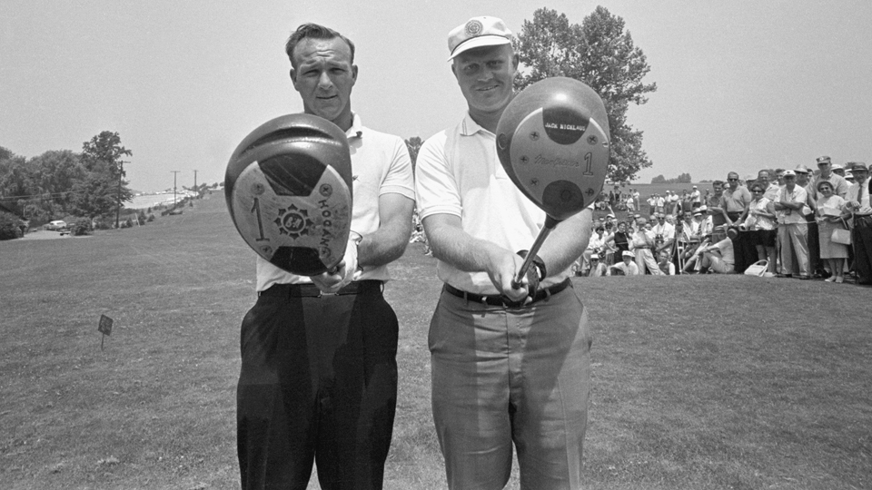 Golfers Arnold Palmer and Jack Nicklaus check their drivers before teeing off for a tie-breaking playoff in the 1962 US Open.