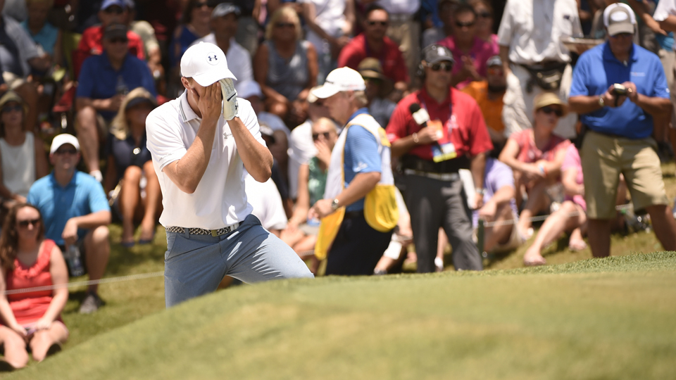 Jordan Spieth covers his face after hitting out of the bunker on the 9th hole during Thursday's opening round of the Players. Spieth shot an even par 72 in his first round since the Masters.