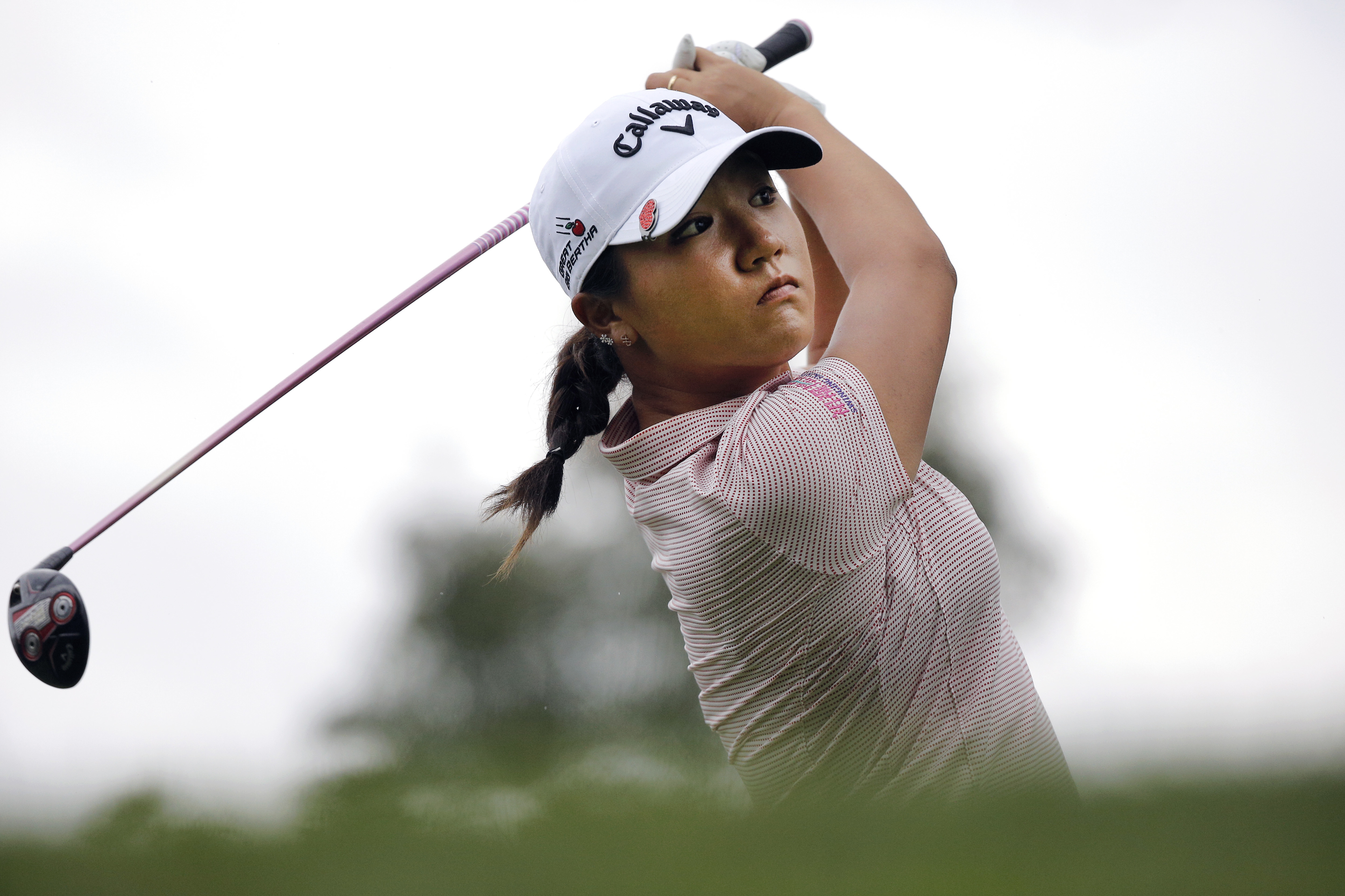Lydia Ko, of New Zealand, follows her ball after playing on the 7th hole during the first round of the Evian Championship women's golf tournament in Evian, eastern France, Thursday, Sept. 15, 2016. (AP Photo/Laurent