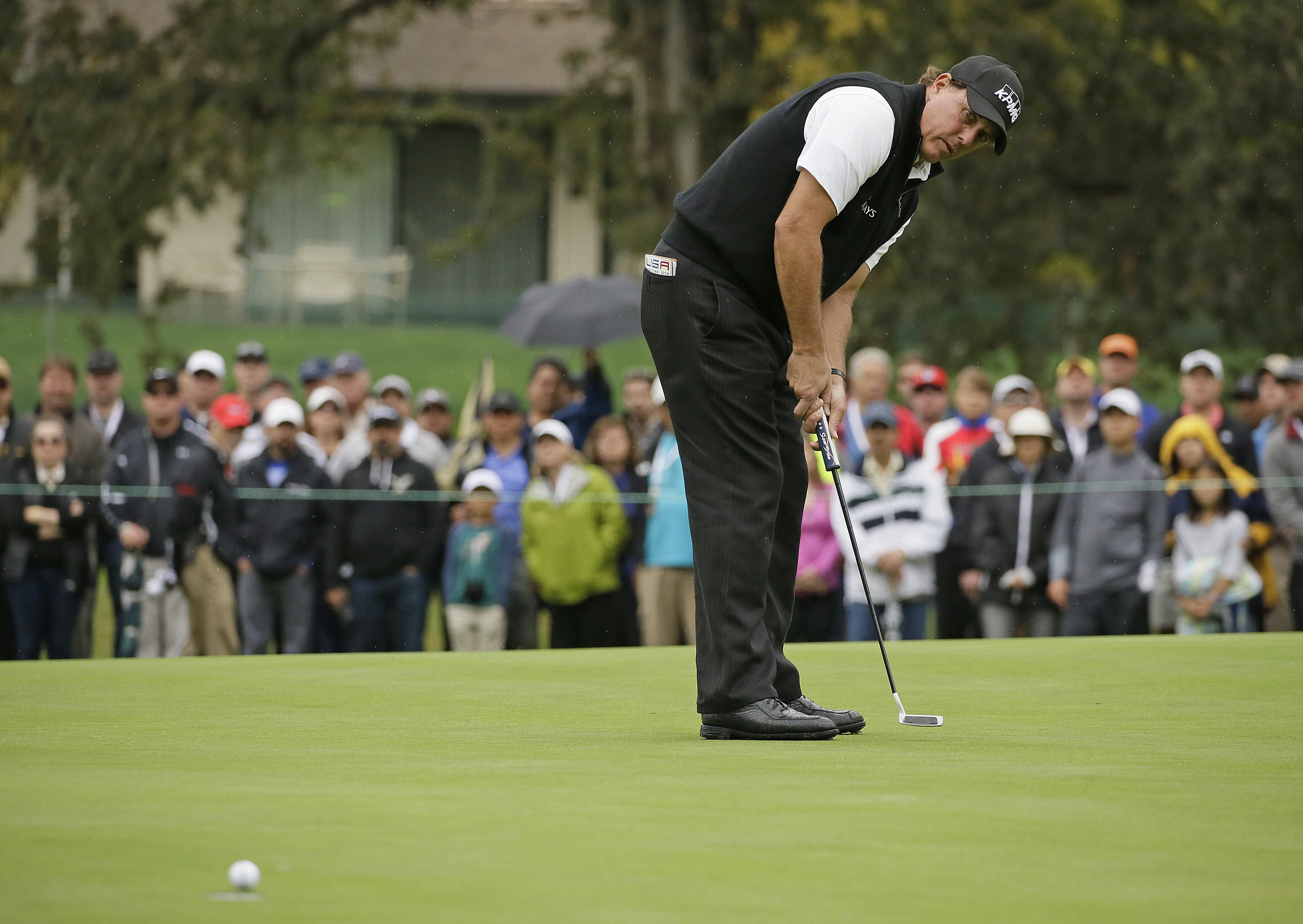 Phil Mickelson makes a birdie putt on the first green of the Silverado Resort North Course during the final round of the Safeway Open PGA golf tournament, Sunday, Oct. 16, 2016, in Napa, Calif. (AP Photo/Eric