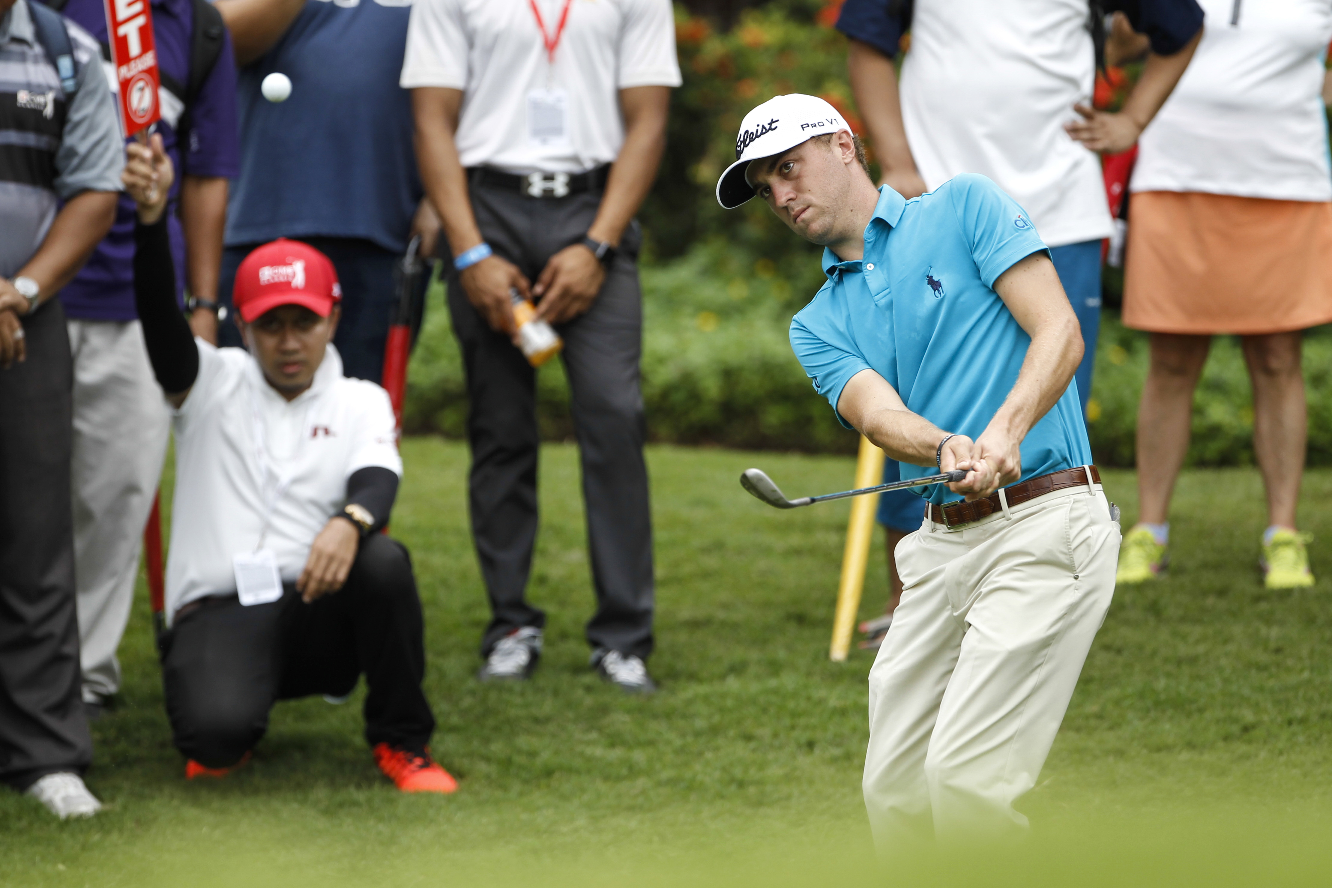 Justin Thomas watches his shot on the fifth green during the third round of the CIMB Classic.