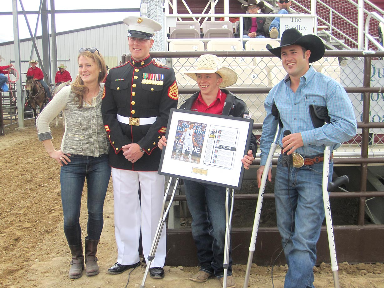 Sports Illustrated reporter Ali Fenwick and Staff Sgt. Wesley Johnson join four-time bareback world champion Kaycee Feild (far right) in honoring Wyatt Johnson (center), the Sports Illustrated High School Athlete of the Month for April.