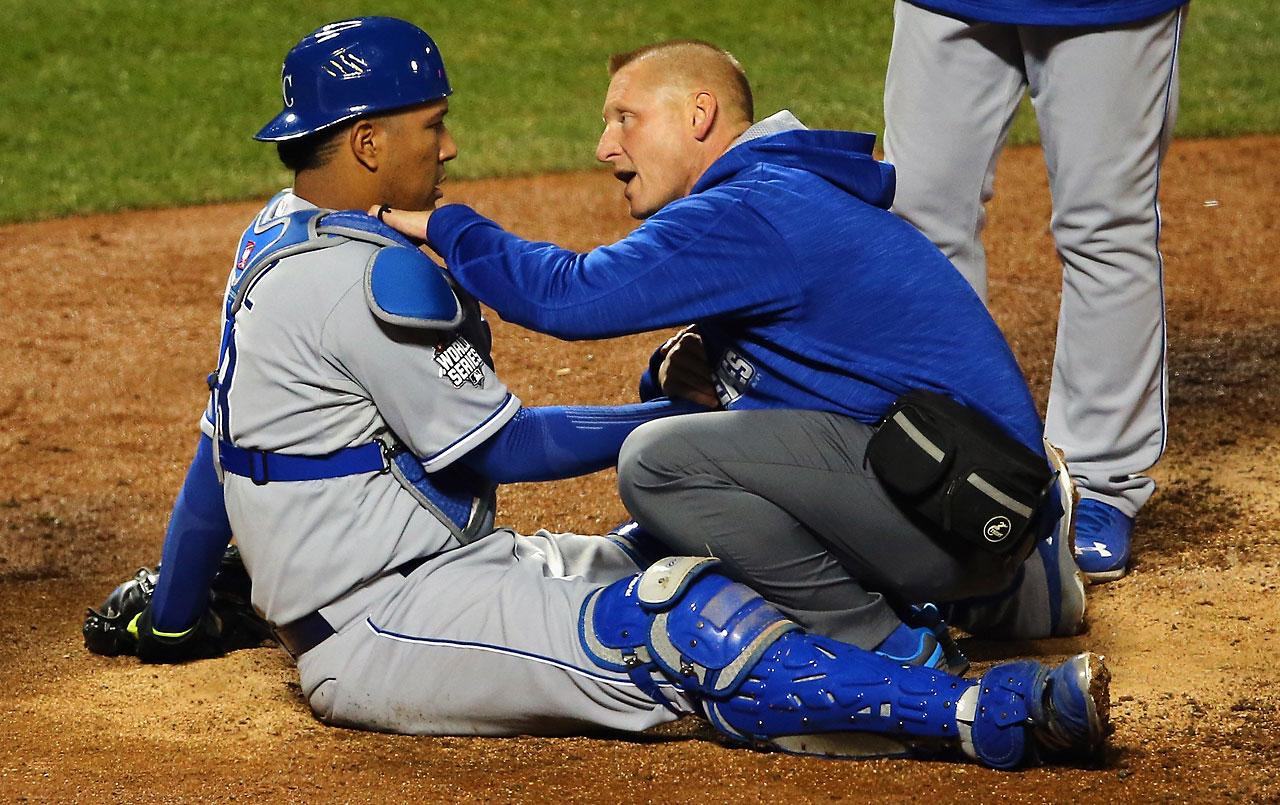 Salvador Perez is checked out after getting hit by a ball in the eight inning.