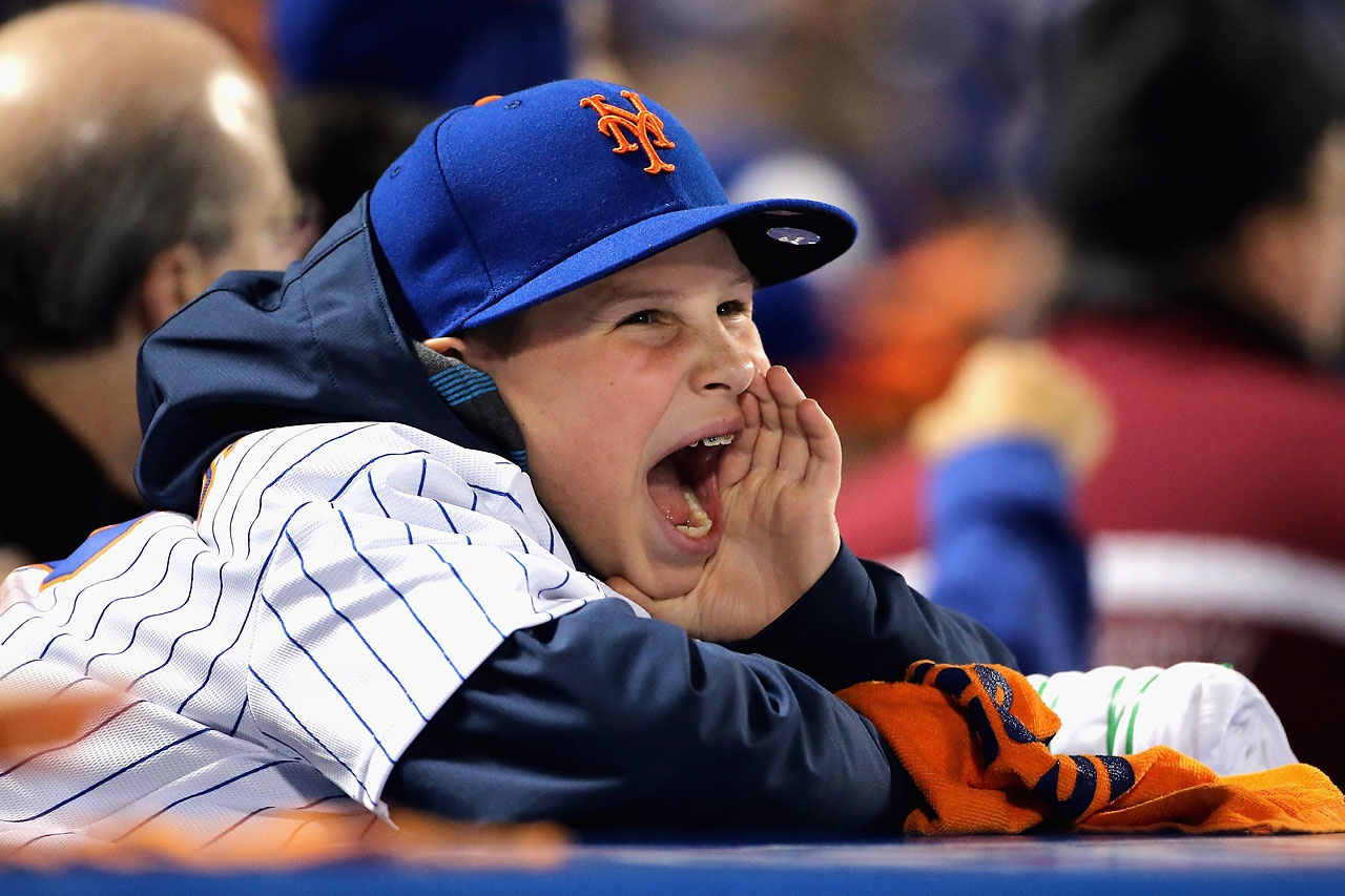 A young New York Mets fan cheers during Game 4.