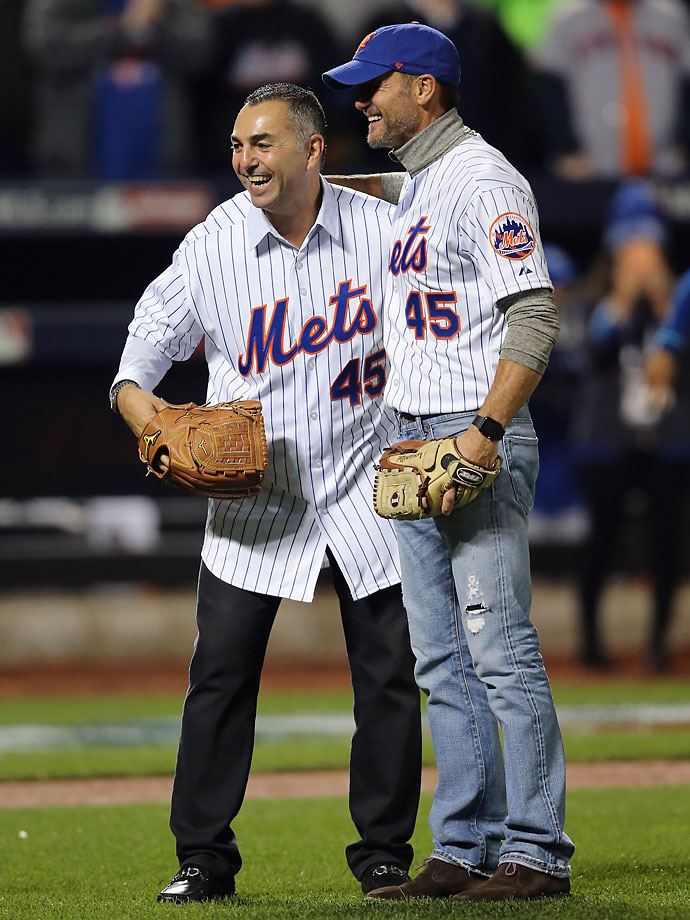Singer Tim McGraw reacts after throwing out the first pitch to John Franco prior to Game 4.