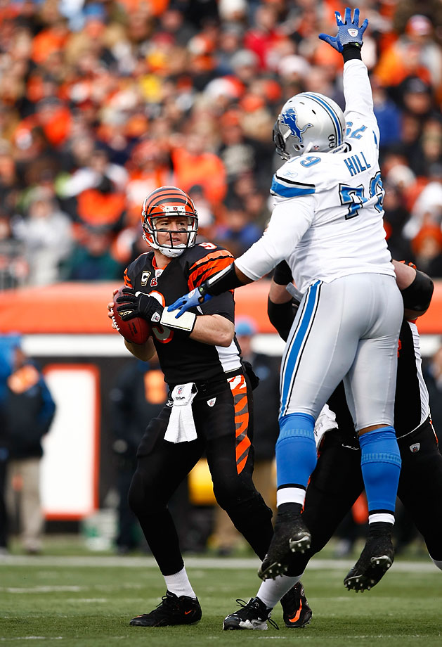 Palmer looks to pass while under pressure from Sammie Hill of the Detroit Lions during one of the Bengals 10 victories in the 2009 season.