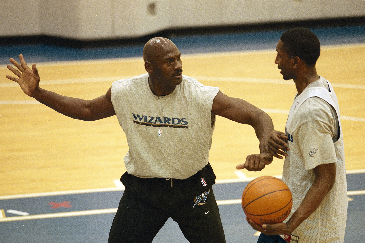 Washington Wizards executive Michael Jordan giving some advice to players during practice in 2000.