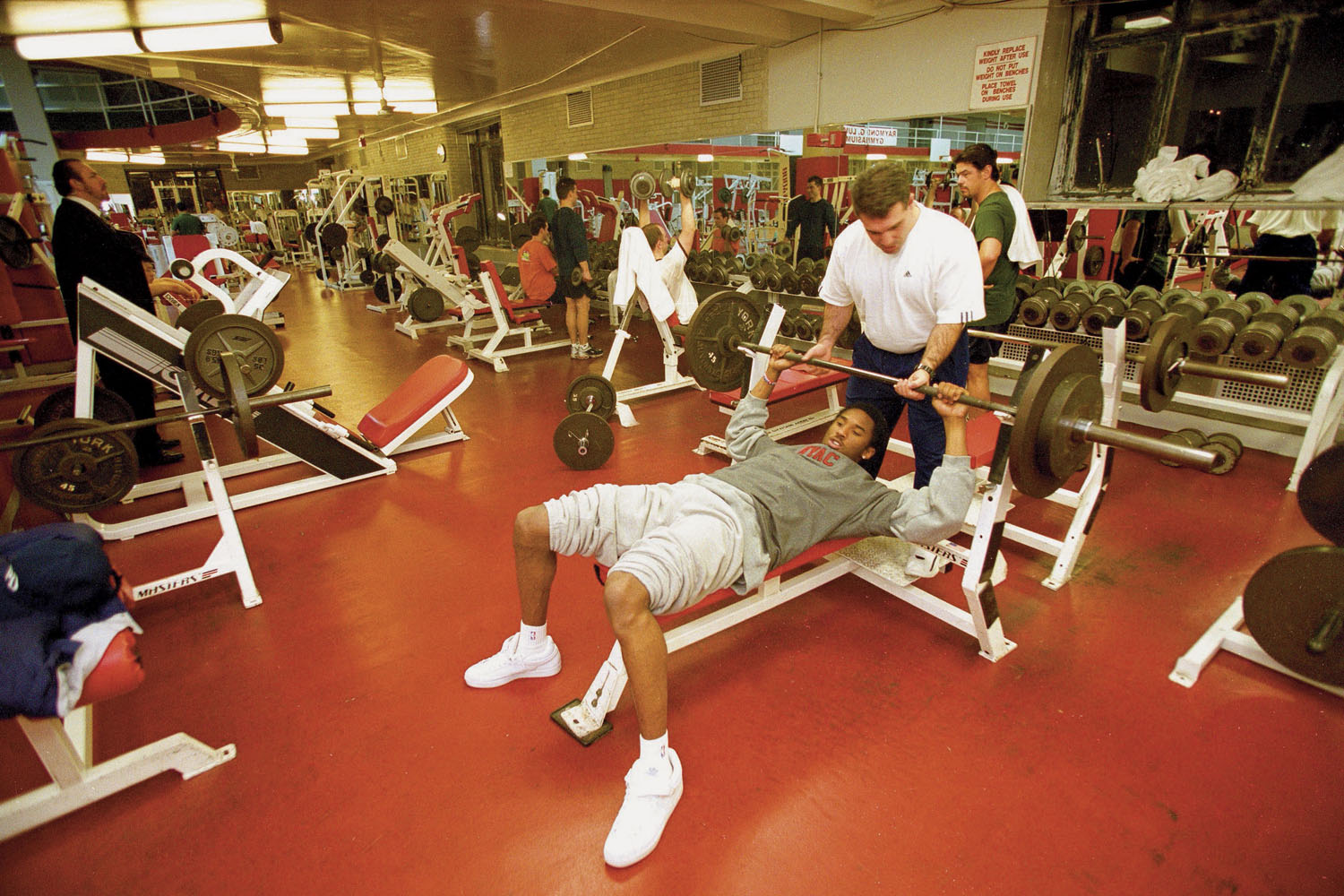 Los Angeles Lakers Kobe Bryant in action, lifting weights with his trainer at the New York Athletic Club in 2002.